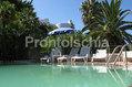 Paco Residence - La piscina termale con il solarium attrezzato